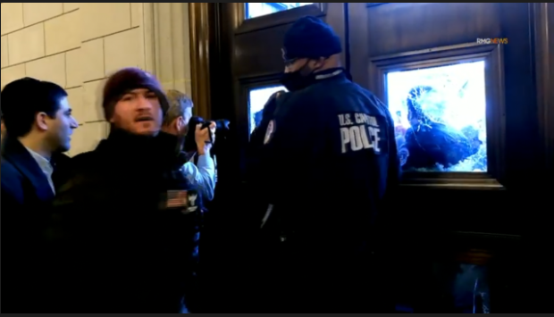 Rioter Scolds Capitol Hill Policeman (Video)