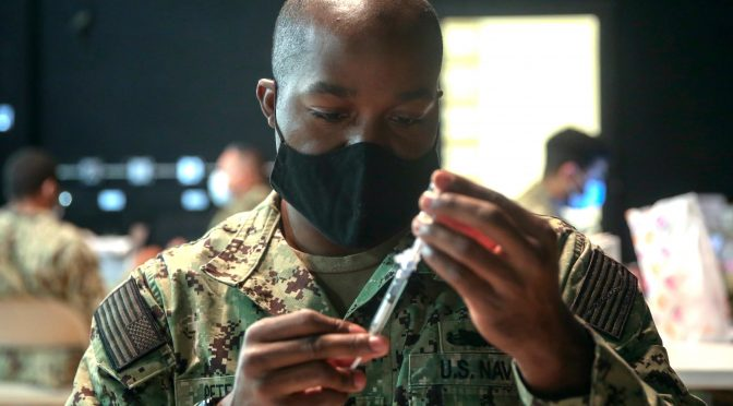Wristbands and Dining Cards: New Army Policies Exclude, Isolate Unvaccinated
